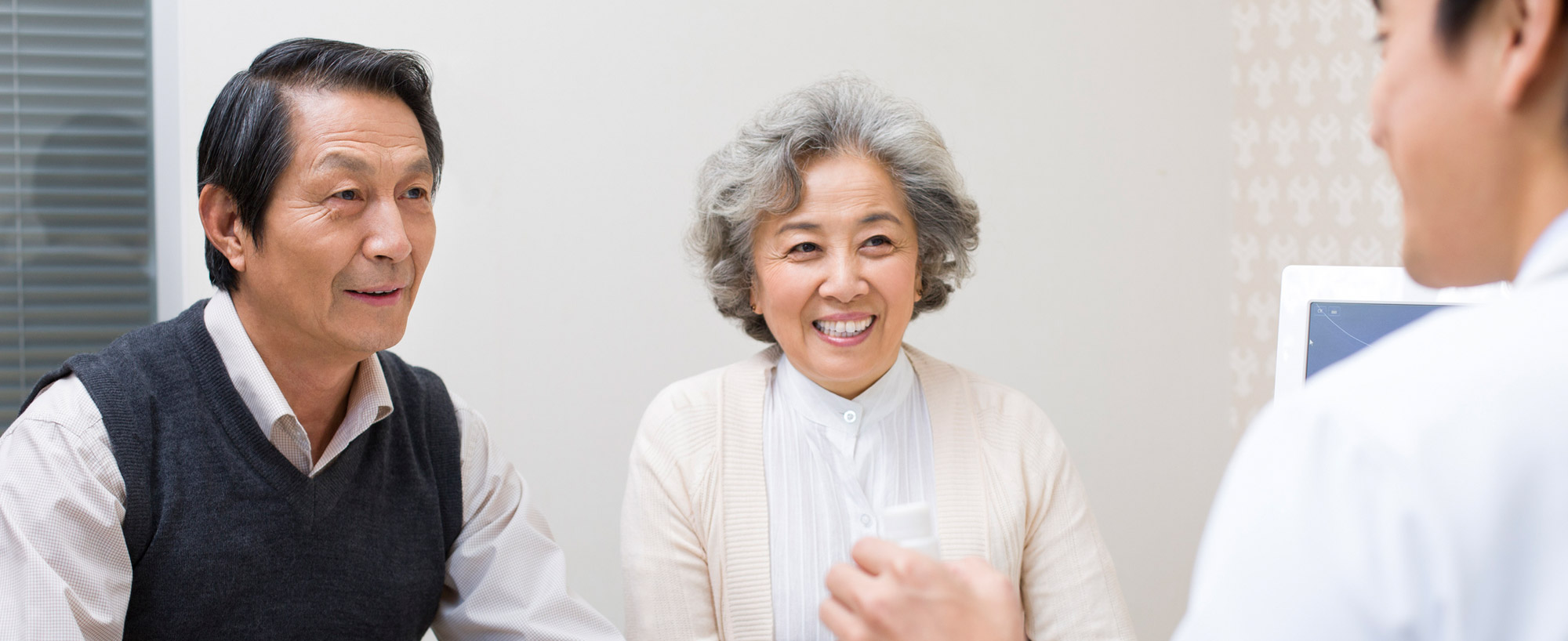 Senior couple meet with doctor